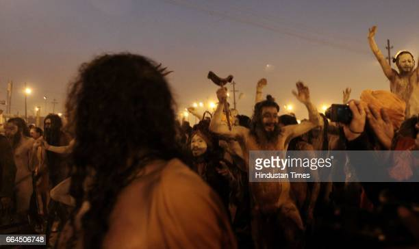 'Naga sadhus' perform rituals on the banks of the Ganga River during the MahaKumbh festival in Allahabad