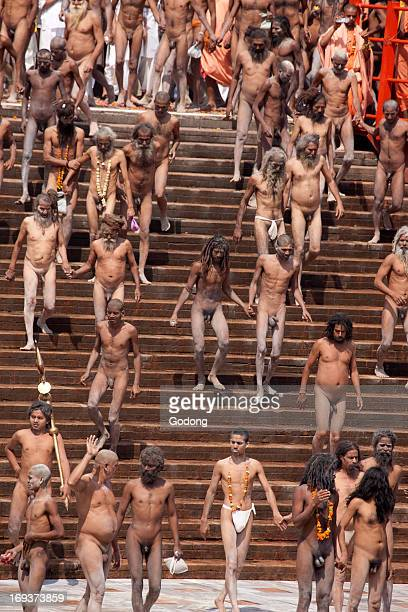 Naga sadhus walking down the steps of HarkiPauri ghat to take a dip in the river Ganges on the occasion of 'Somvati Amavasya' a no moon day in the...