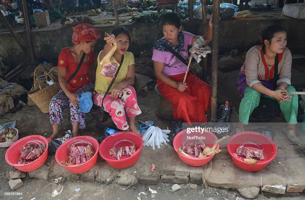 Naga women sell dog meat at a daily market in Dimapur, India northeastern state of Nagaland on Wednesday, March 16, 2016. Dog meat, a delicacy food for the tribal people of Nagas, is eaten openly with high demand and to a smaller extent in Mizoram state. Alive Dog and its meat were sold in market for consumption.