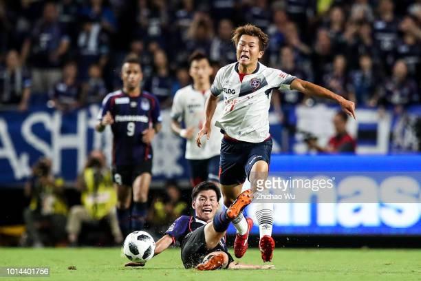 Nagai Kensuke of FC Tokyo competes for the ball against Ko Takahiro of Gamba Osaka during the JLeague J1 match between Gamba Osaka and FC Tokyo at...