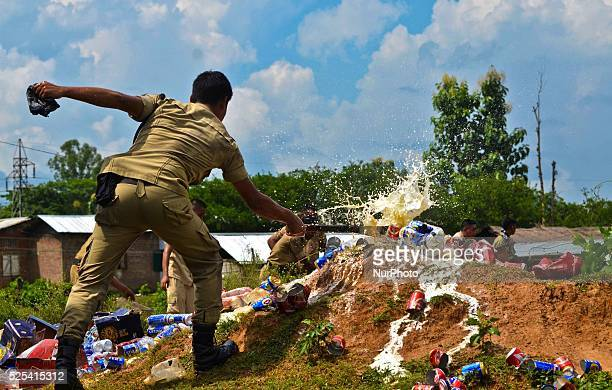 Nagaland police personnel destroying the seize Indian Made Foreign Liquor with a machete during the destruction at Dimapur India north eastern state...