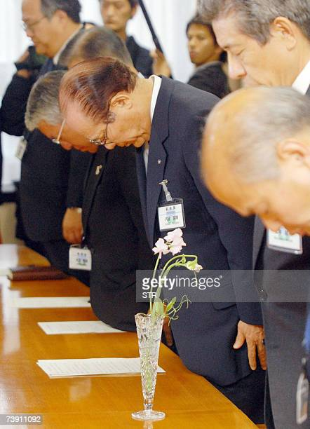 Nagasaki city executives bow their heads to offer a silent prayer at Nagasaki city offices for Nagasaki Mayor Iccho Ito who as shot dead by a...