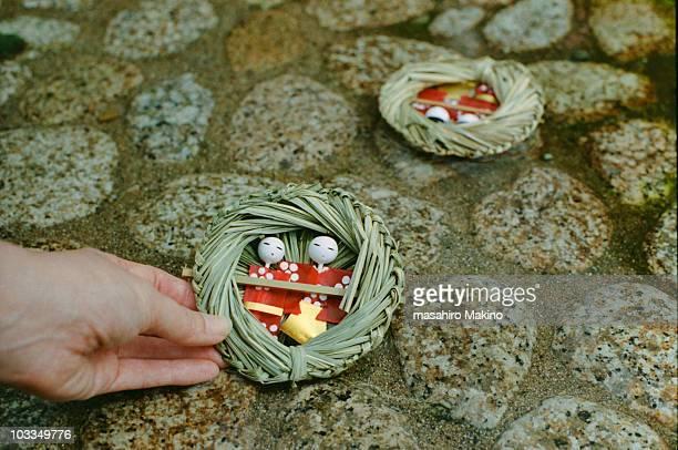 nagashi-bina figure - hinamatsuri stock pictures, royalty-free photos & images