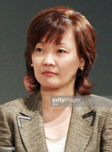 In this photo taken 12 August 2006 shows Akie Abe wife of Japanese Chief Cabinet Secretary Shinzo Abe listening at a campaign for the ruling Liberal...