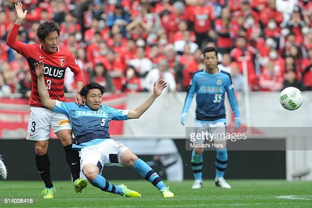 Nagisa Sakurauchi of Jubilo Iwata and Tomoya Ugajin of Urawa Red Diamonds compete for the ball during the J.League match between Urawa Red Diamonds...