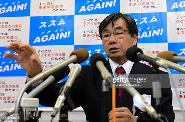Nago City Mayor Susumu Inamine speaks during a press conference a day after he was reelected at Nago city hall on January 20 2014 in Nago Okinawa...