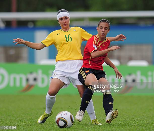 Nagore Calderon of Spain is tackled by Jucinara of Brazil during the FIFA U17 Women's World Cup Quarter Final match between Spain and Brazil at the...