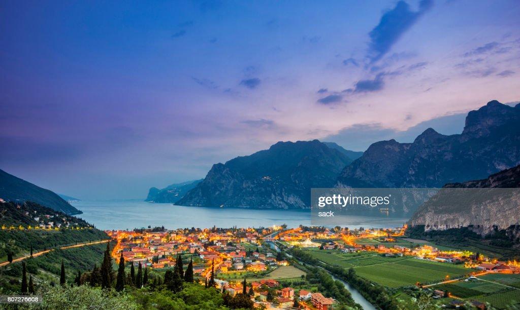 Nago-Torbole and Lake Garda at sunset : Stock Photo