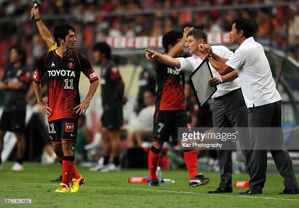 Nagoya Grampus manager Dragan Stojkovic instructs to Keiji Tamada during the J.League match between Nagoya Grampus and Urawa Red Diamonds at Toyota...