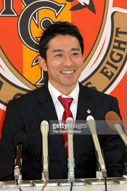 Nagoya Grampus new signing Keiji Tamada speaks during a press conference at Toyota Sports Center on January 11 2017 in Toyota Aichi Japan