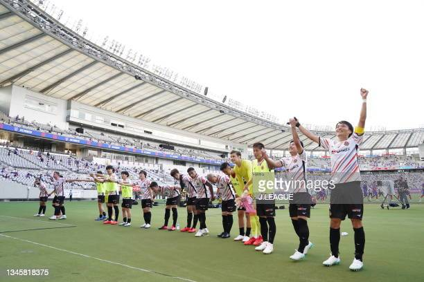 Nagoya Grampus players applaud fans after the J.League Levain Cup Semi Final second leg match between FC Tokyo and Nagoya Grampus at Ajinomoto...
