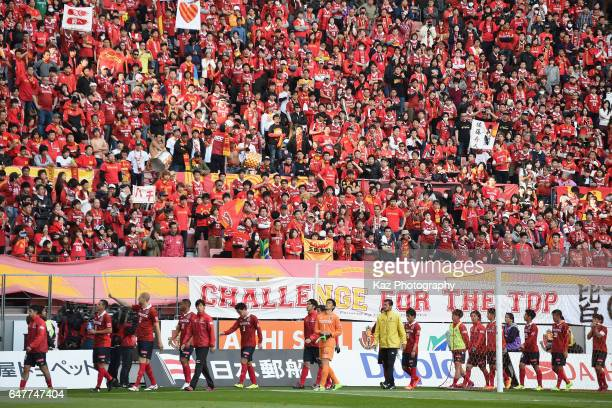 Nagoya Grampus players applaud supporters after their 11 draw in the JLeague J2 match between Nagoya Grampus and FC Gifu at Toyota Stadium on March 4...