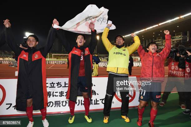 Nagoya Grampus players applaud supporters after their 42 victory in the JLeague J1 Promotion PlayOff semi final match between Nagoya Grampus and JEF...