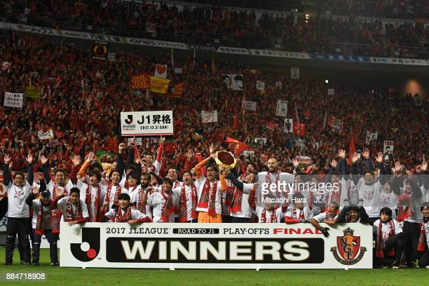 Nagoya Grampus players applaud supporters after their promotion to the J1 after the JLeague J1 Promotion PlayOff Final between Nagoya Grampus and...