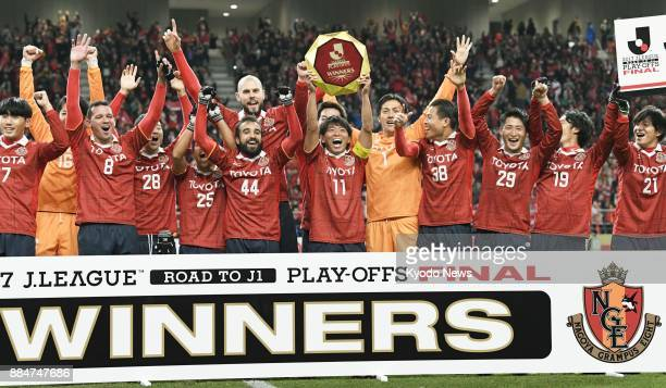 Nagoya Grampus players celebrate after securing promotion to the JLeague first division against Avispa Fukuoka in the seconddivision playoff final at...