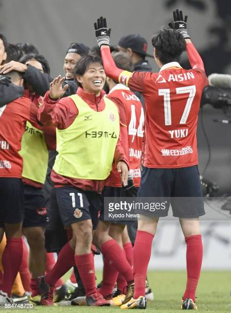 Nagoya Grampus players celebrate after securing promotion to the JLeague first division with a 00 draw to Avispa Fukuoka in the seconddivision...