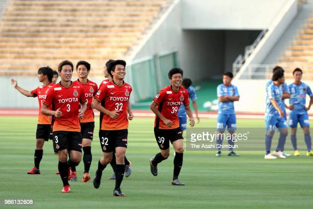 Nagoya Grampus players celebrate after the replay of the penalty shootout of the 98th Emperor's Cup second round match between Nagoya Grampus and...