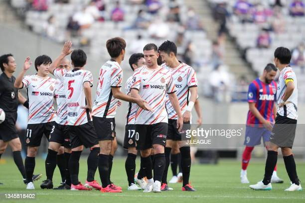 Nagoya Grampus players celebrate their victory after the J.League Levain Cup Semi Final second leg match between FC Tokyo and Nagoya Grampus at...