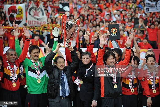 Nagoya Grampus players celebrate with Toyota Motor Corporation President Akio Toyoda and Nagoya Grampus head coach Dragan Stojkovic after winning the...