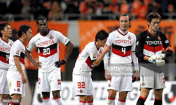Nagoya Grampus players react after the JLeague match between Albirex Niigata and Nagoya Grampus at Tohoku Denryoku Big Swan Stadium on December 3...