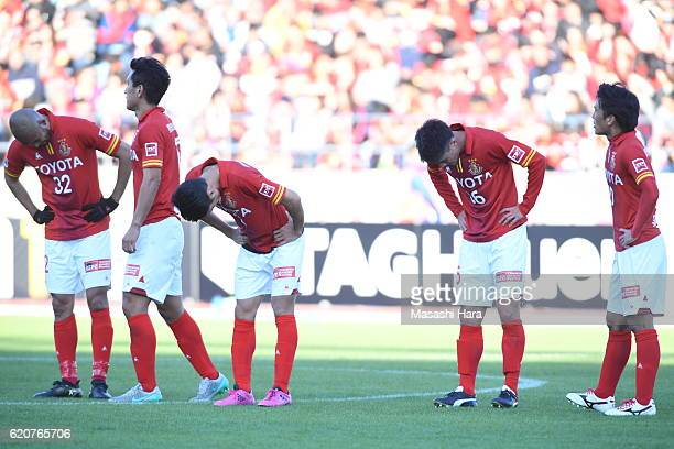 Nagoya Grampus players show their dejection after their relegation to the second division after the J.League match between Nagoya Grampus and Shonan...