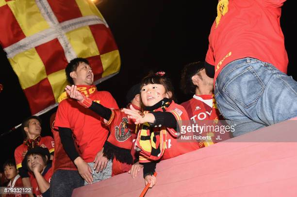 Nagoya Grampus supporters celebrate their team's 42 victory in the JLeague J1 Promotion PlayOff semi final match between Nagoya Grampus and JEF...