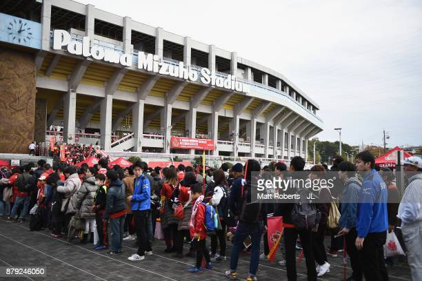 Nagoya Grampus supporters make their way to the stadium prior to the J.League J1 Promotion Play-Off semi final match between Nagoya Grampus and JEF...