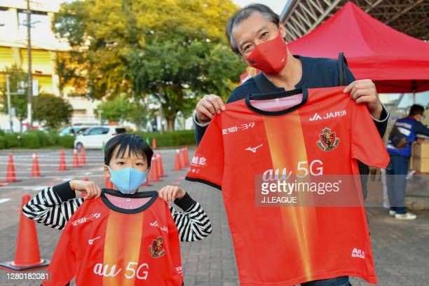 Nagoya Grampus supporters pose for a photo prior to the J.League Meiji Yasuda J1 match between Nagoya Grampus and Consadole Sapporo at Paloma Mizuho...