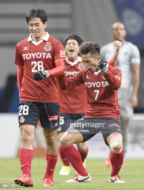Nagoya Grampus' Taishi Taguchi and Keiji Tamada react after securing promotion to the JLeague first division against Avispa Fukuoka in the second...