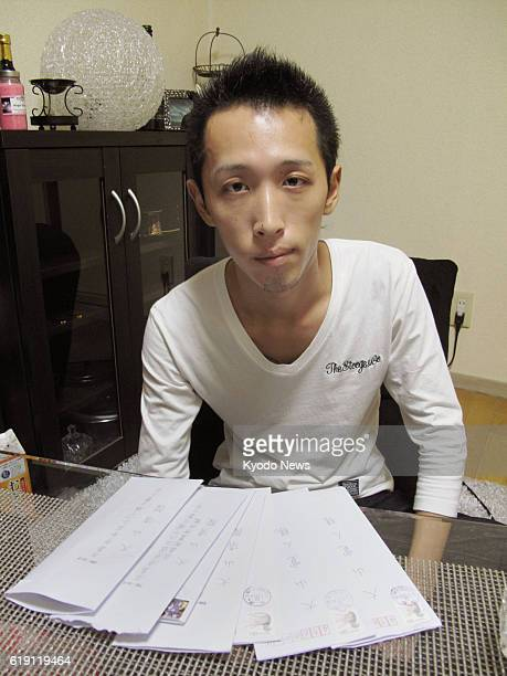 Nagoya Japan Hiroto Oyama shows letters from his father a condemned prisoner at the Hiroshima Detention House who was convicted of killing his mother...