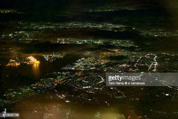 Nagoya port and city in Aichi prefecture in Japan night time aerial view from airplane