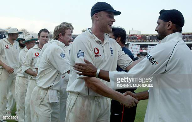 England cricket captain Andrew Flintoff leads his team as they shake hands with Indian cricketers including Harbhajan Singh at the close of play on...