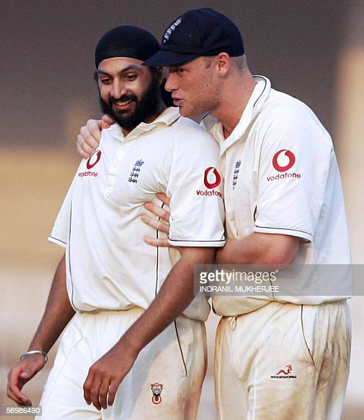 England cricket team captain Andrew Flintoff hugs teammate Monty Panesar as they walk back to the pavilion at the end of the third day of the first...