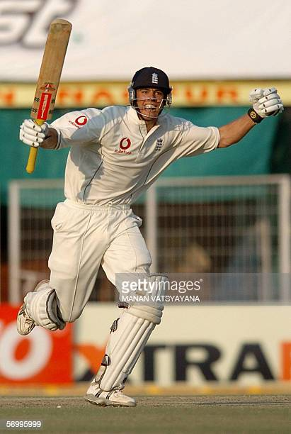 England cricketer Alastair Cook celebrates after scoring his maiden century on his Test match debut during play on the fourth day of the first Test...