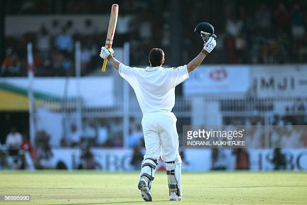 England cricketer Alastair Cook raises his bat and helmet into the air as he celebrates after scoring his maiden century on his Test match debut on...