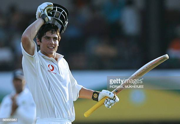 England cricketer Alastair Cook removes his helmet as he celebrates after scoring his maiden century on his Test match debut on the fourth day of the...