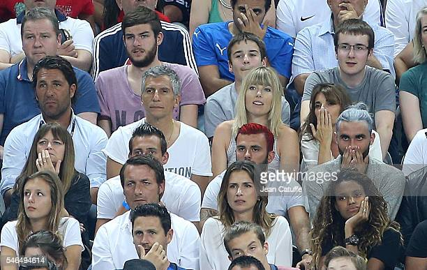 Nagui and his wife Melanie Page attend the UEFA Euro 2016 final between Portugal and France at Stade de France on July 10 2016 in SaintDenis near...