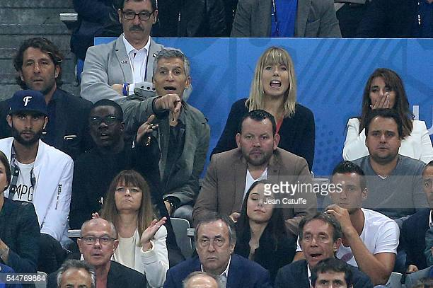 Nagui and his wife Melanie Page attend the UEFA Euro 2016 quarter final match between France and Iceland at Stade de France on July 3 2016 in...