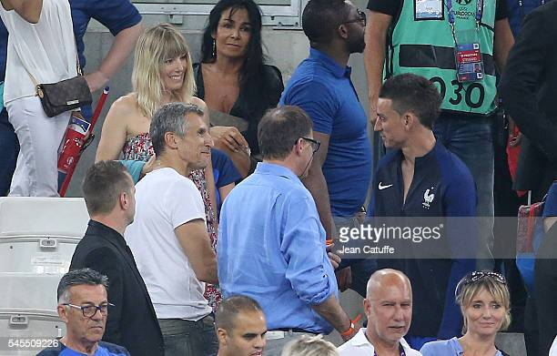 Nagui and his wife Melanie Page greets Laurent Koscielny of France following the UEFA Euro 2016 semifinal match between Germany and France at Stade...
