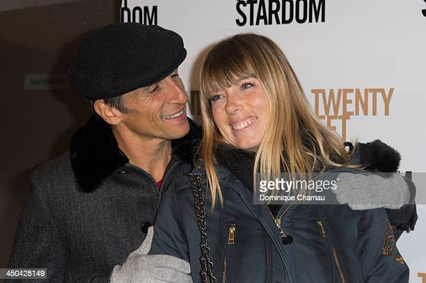 Nagui and wife Melanie Page attend the '20 Feet from Stardom' Paris premiere at Cinema UGC Normandie on November 18 2013 in Paris France