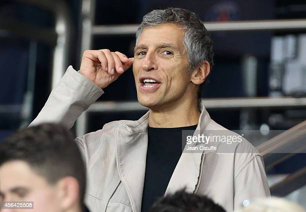 Nagui attends the UEFA Champions League Group F match between Paris SaintGermain FC and FC Barcelona at the Parc des Princes stadium on September 30...