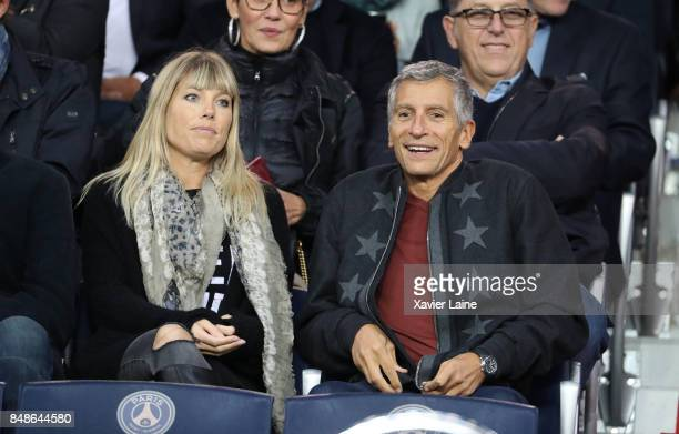 Nagui Fam and his wife Mlanie Page attend the French Ligue 1 match between Paris Saint Germain and Olympique Lyonnais at Parc des Princes on...