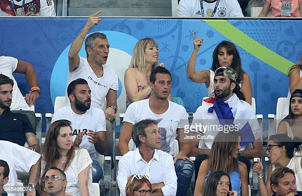 Nagui Melanie Page Claude Deschamps wife of Didier Deschamps attend the UEFA Euro 2016 semifinal match between Germany and France at Stade Velodrome...