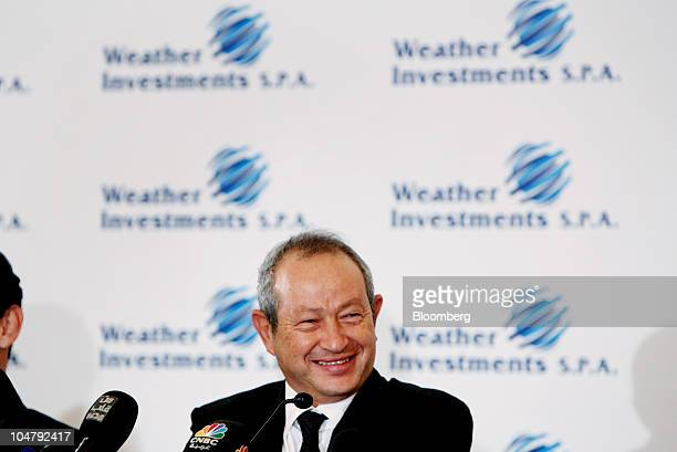 Naguib Sawiris chairman of Orascom Telecom Holding SAE smiles during a press conference at the company's headquarters in Cairo Egypt on Tuesday Oct 5...