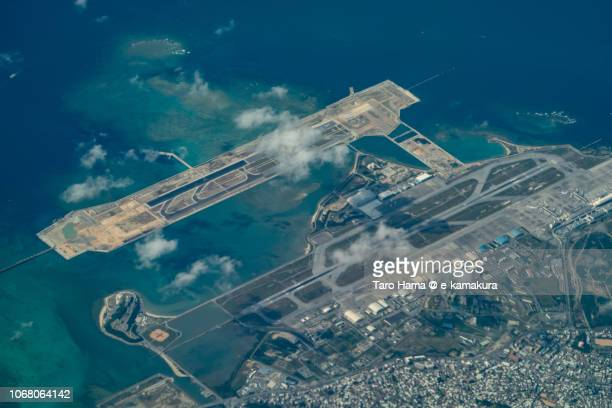 Naha Airport (OKA) in Japan daytime aerial view from airplane