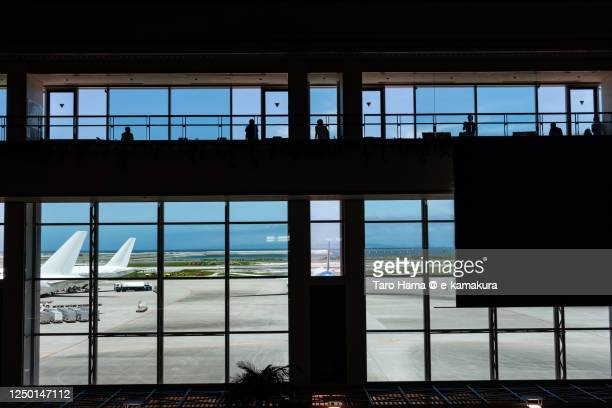 naha airport in okinawa prefecture of japan - taro hama ストックフォトと画像