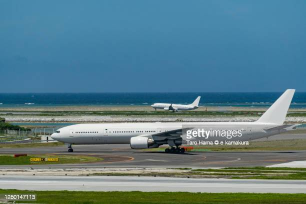 naha airport in okinawa prefecture of japan - 軍艦 ストックフォトと画像