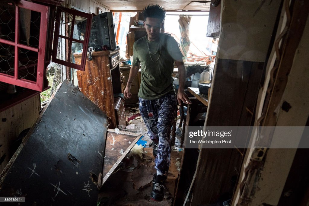Nahan Valdez gathers supplies out of his destroyed home to take back to a shelter near City-By-The Sea, TX as Hurricane Harvey hits the Texas coast on Saturday, Aug 26, 2017.