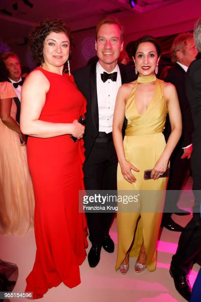 Nahid Shahalimi Nils Behrens and Laila Hamidi during the Rosenball charity event at Hotel Intercontinental on May 5 2018 in Berlin Germany