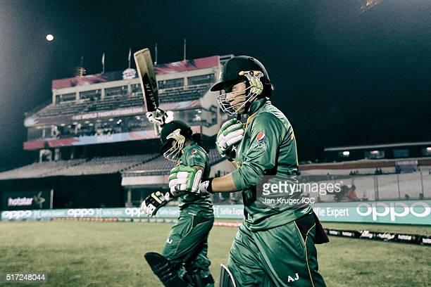 Nahida Khan and Sidra Ameen of Pakistan makes their way out to bat during the Women's ICC World Twenty20 India 2016 match between Pakistan and...